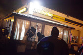 Looters throw chairs through the windows of a store as protests engulf Ferguson on November 26 2014 in Ferguson Missouri Over 2000 Missouri national...