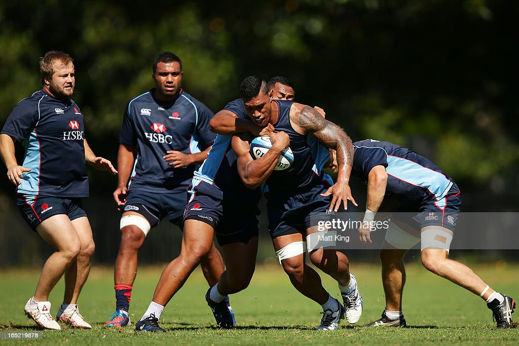 Lopeti Timani is tackled during a Waratahs Super Rugby training session at Moore Park on April 2, 2013 in Sydney, Australia.