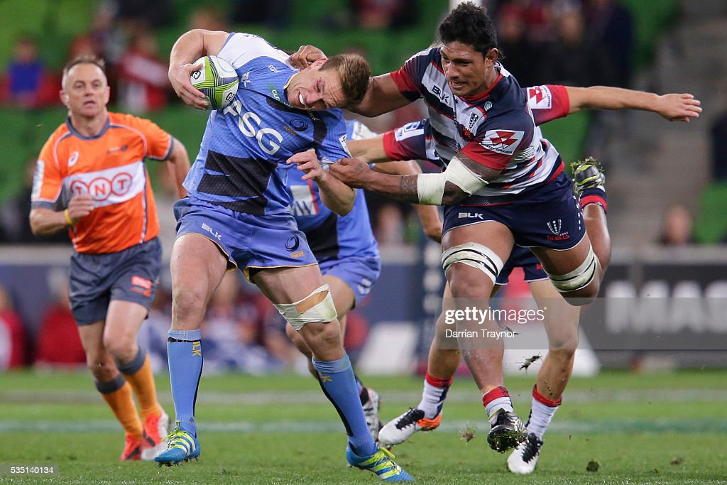 Lopeti Timani of the Rebels tackles Dane Haylett-Petty of the Force during the round 14 Super Rugby match between the Rebels and the Force at AAMI Park on May 29, 2016 in Melbourne, Australia.