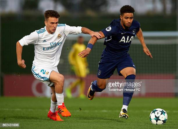 Lopez of Real Madrid competes for the ball with Keanan Bennetts of Tottenham Hotspur during the UEFA Youth Champions League group H match between...