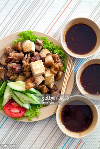 Lor bak pork sausage in beancurd skin served with tofu a Baba dish developed in Phuket by Hokkien Chinese who migrated from the Straits Chinese...