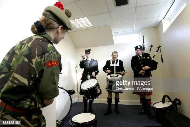 Lora Harwood from the Angus and Dundee cadets watches other cadets warming up at the Annual Bagpiping and Drumming Championships at Inchdrewer House...