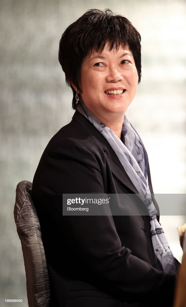 Lora Ho, chief financial officer of Taiwan Semiconductor Manufacturing Co. (TSMC), smiles during a news conference in Taipei, Taiwan, on Thursday, Jan. 17, 2013. Taiwan Semiconductor Manufacturing Co., the world's largest contract producer of chips, forecast sales surpassing analysts' estimates as demand for components used in phones and tablets continues to outstrip expectations. Photographer: Maurice Tsai/Bloomberg via Getty Images