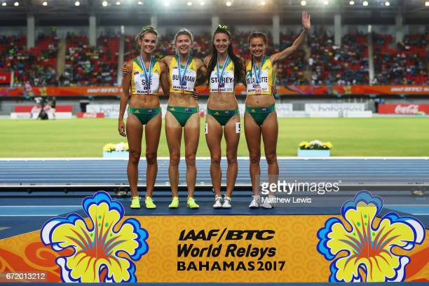 Lora Storey Abbey de la Motte Zoe Buckman Heidi See of Australia celebrate on the podium after placing third in the Women's 4 x 800 Meters Relay...