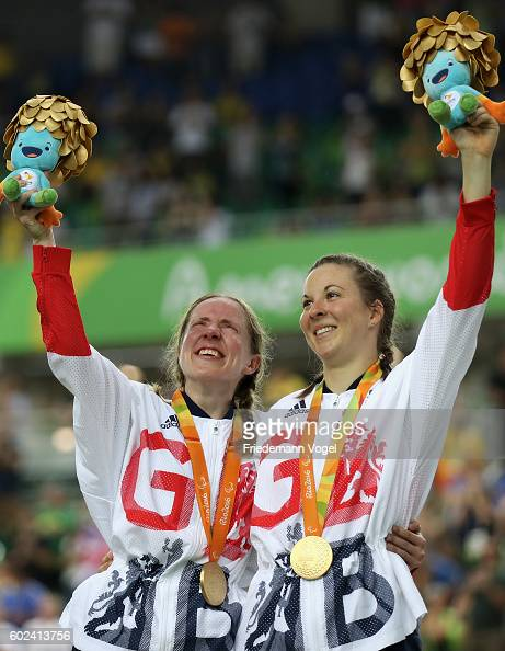Lora Turnham and Corrine Hall of Great Bitain celebrate on the podium at the medal ceremony for Women's B 3000m Individual Pursuit Track Cycling on...