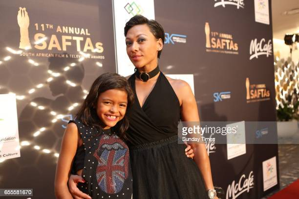 Lorcia Cooper and her daughter pose on the red carpet during the South African Film and Television Awards at Sun City on March 18 2017 in Rustenburg...