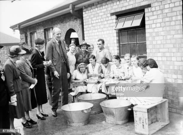 Lord and Lady Halifax seen here visiting a communal kitchen Circa 1939