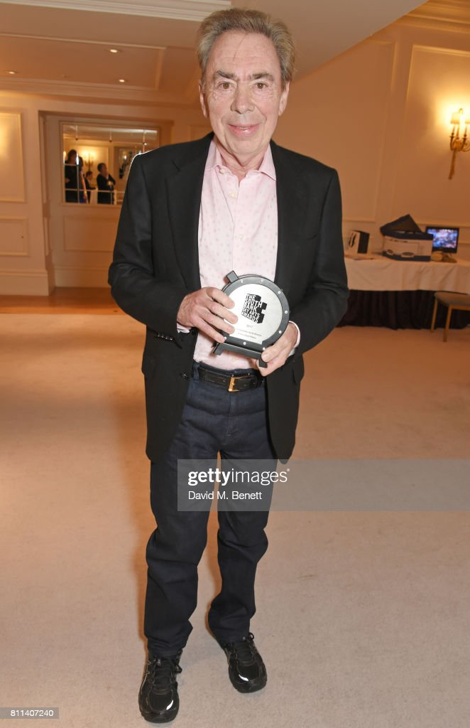 Lord Andrew Lloyd Webber, winner of the Outstanding Achievement Award, poses in the winners room at The South Bank Sky Arts Awards at The Savoy Hotel on July 9, 2017 in London, England.