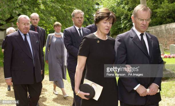 Lord Archer and his wife Mary leave the Parish church of St Andrew and St Mary in Grantchester Cambridgeshire after the memorial service of Archer's...