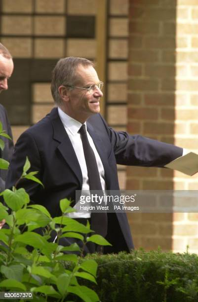 Lord Archer leaves Cambridge Crematorium in Madingley with an unidentified man to get into a prison van following the funeral of his mother Lola...
