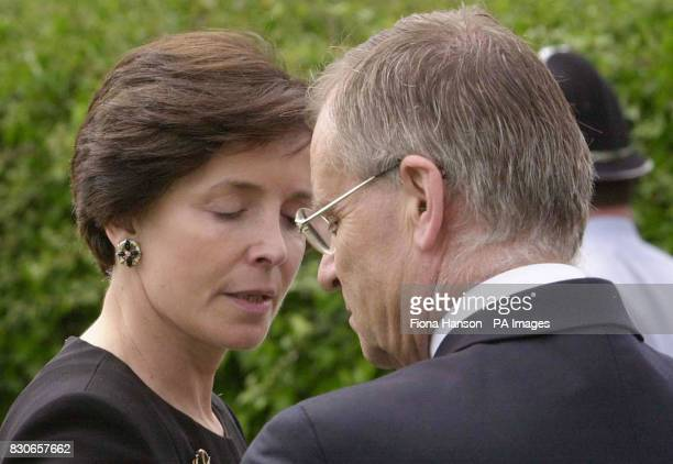 Lord Archer says goodbye to his Wife Mary outside Cambridge Crematorium in Madingley before getting into a prison van following the funeral of his...