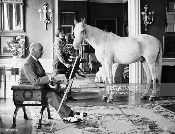 Lord Berners painting a picture of Mrs P Betjeman and her Arab pony at his home in Berkshire 1938