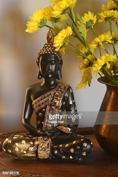 Lord Buddha statue/idol with yellow flowers
