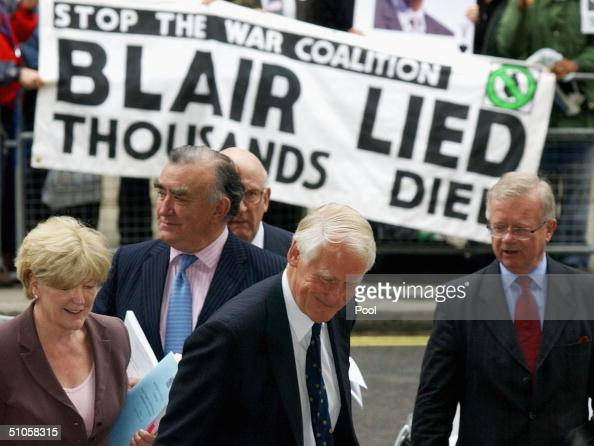 Lord Butler and his team Ann Taylor Michael Mates Lord Inge and Sir John Chilcott arrive for a news conference for his report on the intelligence...