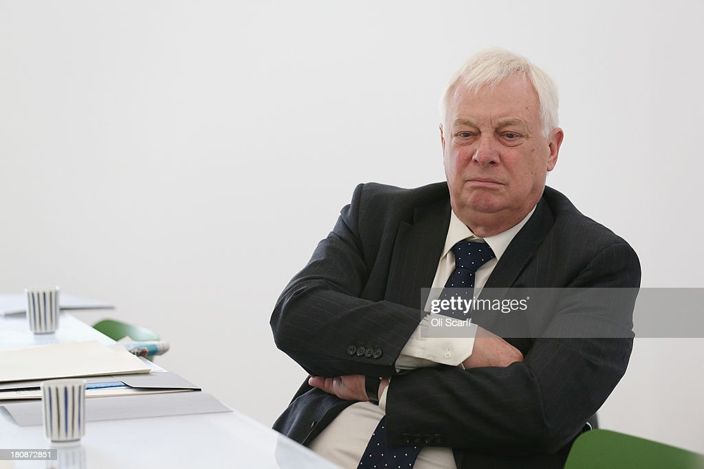 Lord Chris Patten sits in Sculptor Anthony Gormley's studio following the announcement that Mr Gormley has been awarded the Sculpture Laureate in the Praemium Imperiale art prize on September 17, 2013 in London, England. The Praemium Imperiale Awards, presented by the Japan Art Association whose Honorary Patron is Japan's HIH Prince Hitachi, are awarded to 5 Laureates each year in the fields of: Painting, Sculpture, Architecture, Music and Theatre/Film. Lord Chris Patten is one of 6 International Advisers to the award. Each Laureate will receive a prize of 15 million yen, making it the world's richest arts award. The 2013 Laureates are: Michelangelo Pistoletto (painting), Anthony Gormley (sculpture), David Chipperfield (architecture), Placido Domingo (music) and Francis Ford Coppola (theatre/film).