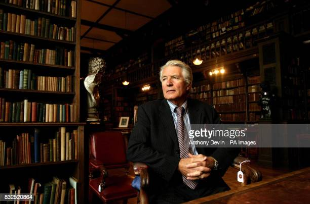 Lord Coleridge poses in the library at The Chanter's House