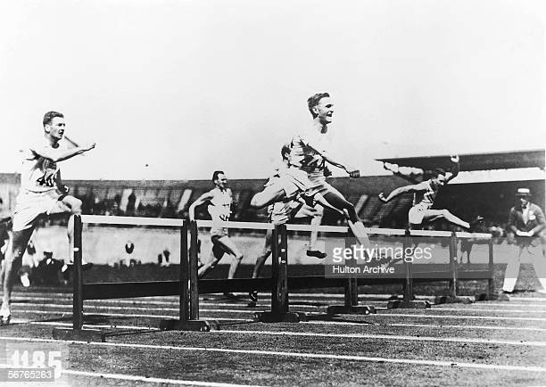 Lord David George Brownlow Cecil 6th Marquess of Exeter on his way to winning the Men's 400Metre Hurdles and equalling the Olympic record of 534...