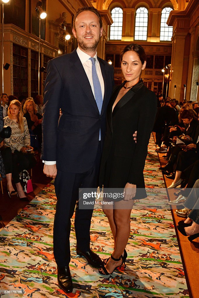Lord Edward Spencer Churchill (L) and Kimberley Hammerstroem attend as Christian Dior showcases its spring summer 2017 cruise collection at Blenheim Palace on May 31, 2016 in Woodstock, England.