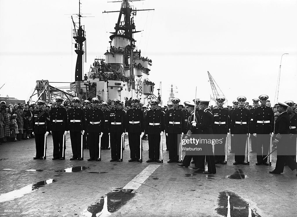 Lord Fraser inspecting British Royal Marines on board the aircraft carrier HMS Theseus as she returns to Portsmouth after serving in Korean waters...