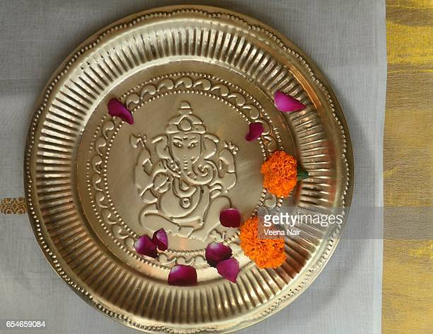 Lord Ganesha engraved on a copper plate/flowers
