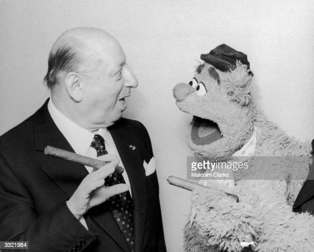 Lord Lew Grade meets Fozzie Bear from the 'Muppet Show' at the Variety Club of Great Britain Show Business Awards Luncheon at the Savoy Hotel London