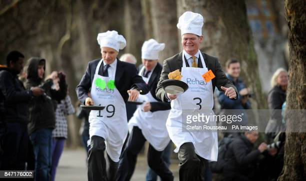 Lord Listowel Rob Hutton from Bloomberg and Stephen Lloyd MP take part in the annual Parliamentary Pancake Race in Westminster today raising money...