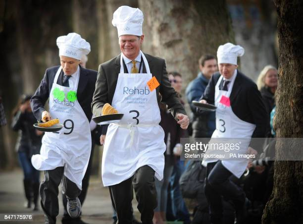 Lord Listowel Stephen Lloyd MP and Rob Hutton from Bloomberg take part in the annual Parliamentary Pancake Race in Westminster today raising money...