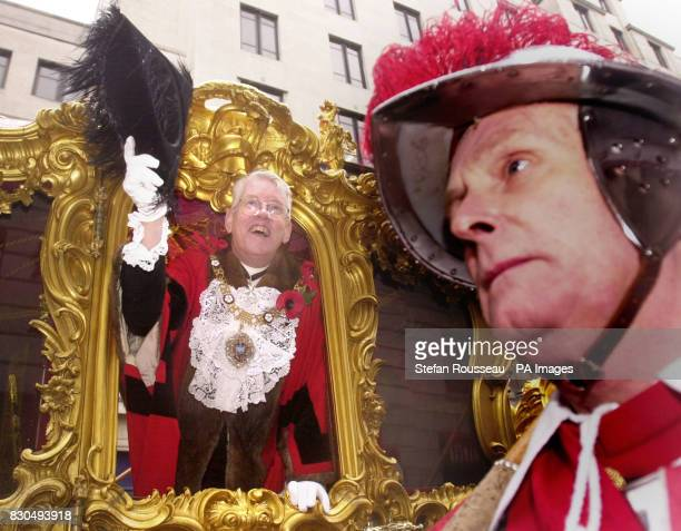 Lord Mayor David Howard waves to the crowd during the Lord Mayor's Show in central London after being sworn in as head the Corporation of London the...