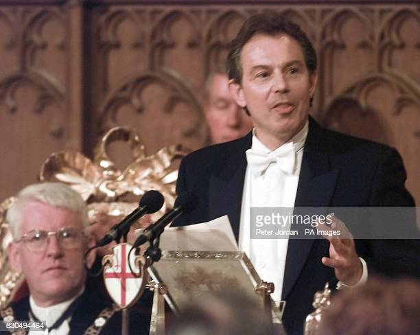 Lord Mayor London David Howard listens to Prime Minister Tony Blair delivering a wideranging foreign policy speech during the Lord Mayor's Banquet at...