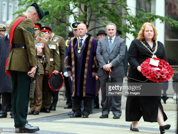 Lord Mayor of Belfast Councillor Naomi Long prepares to lay a wreath at the cenotaph at Belfast City Hall in Northern Ireland