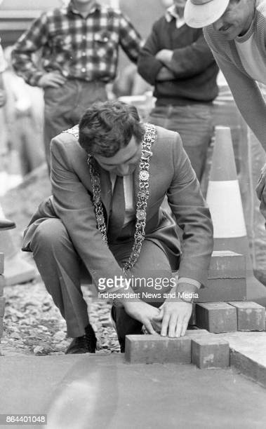 Lord Mayor of Dublin Bertie Ahern lays the first slab of the new paved walkway in Liffy Street a link between Grafton Street and Henry Street October...