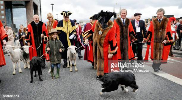 Lord Mayor of London Alderman Ian Luder is inspected by Border Collie Tomba as he shepherdess Henrietta Cropper her dog Try various Aldermen and a...