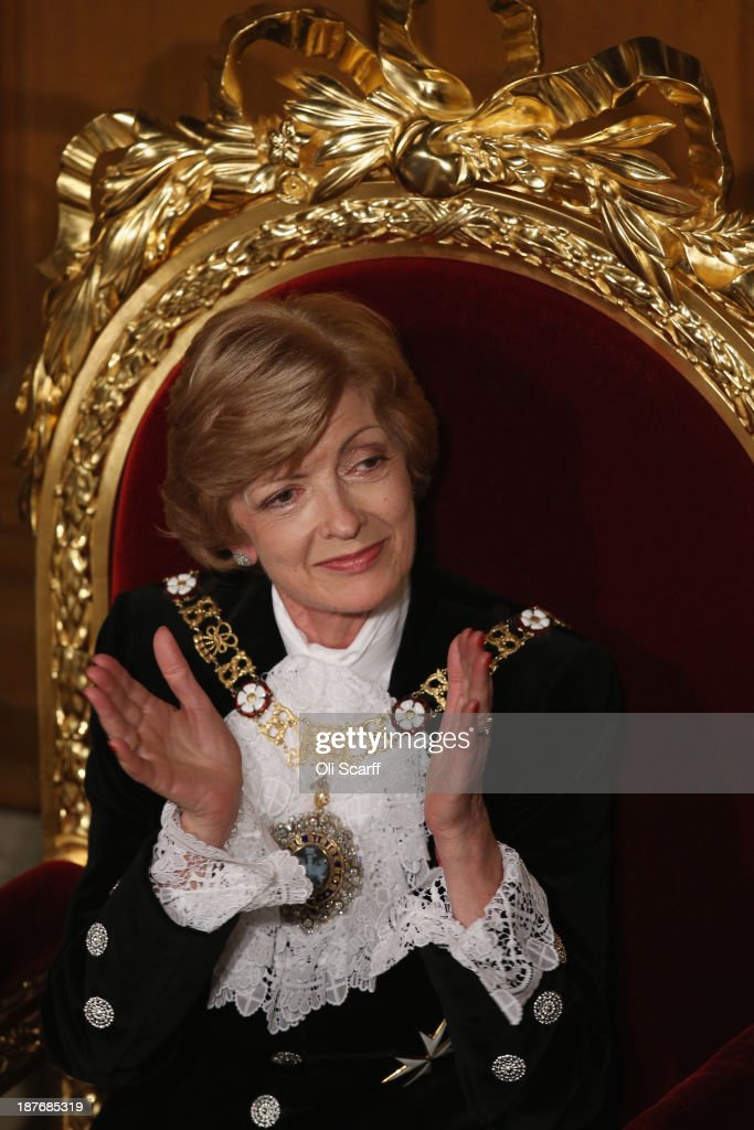 Lord Mayor of London <a gi-track='captionPersonalityLinkClicked' href=/galleries/search?phrase=Fiona+Woolf&family=editorial&specificpeople=10291022 ng-click='$event.stopPropagation()'>Fiona Woolf</a> listens to the speeches in the Guildhall during The Lord Mayor's Banquet on November 11, 2013 in London, England. The New Lord Mayor of London <a gi-track='captionPersonalityLinkClicked' href=/galleries/search?phrase=Fiona+Woolf&family=editorial&specificpeople=10291022 ng-click='$event.stopPropagation()'>Fiona Woolf</a> is hosting the annual Lord Mayor's Banquet in London's Guildhall which will feature speeches from the Prime Minister and the Archbishop of Canterbury. Alderman <a gi-track='captionPersonalityLinkClicked' href=/galleries/search?phrase=Fiona+Woolf&family=editorial&specificpeople=10291022 ng-click='$event.stopPropagation()'>Fiona Woolf</a> has been elected as 686th Lord Mayor of the City of London and the second ever woman to hold the role.