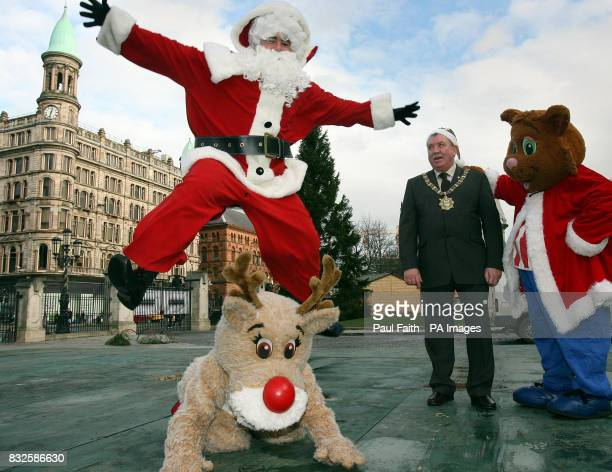 Lord Mayor Pat McCarthy in front of Belfast City Hall with Santa and helpers