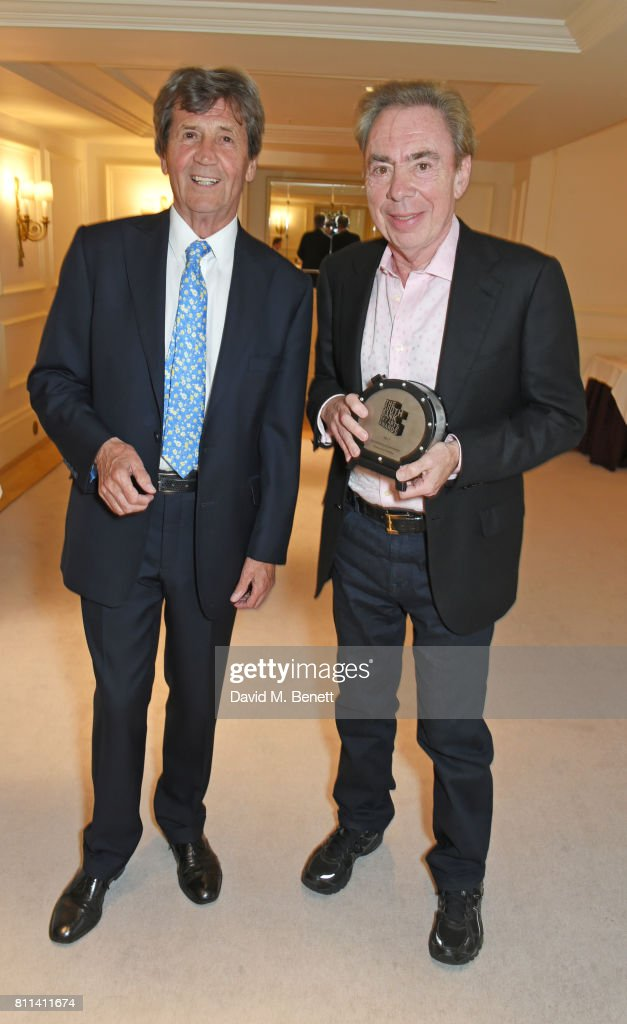 Lord Melvyn Bragg (L) and Lord Andrew Lloyd Webber, winner of the Outstanding Achievement Award, pose in the winners room at The South Bank Sky Arts Awards at The Savoy Hotel on July 9, 2017 in London, England.