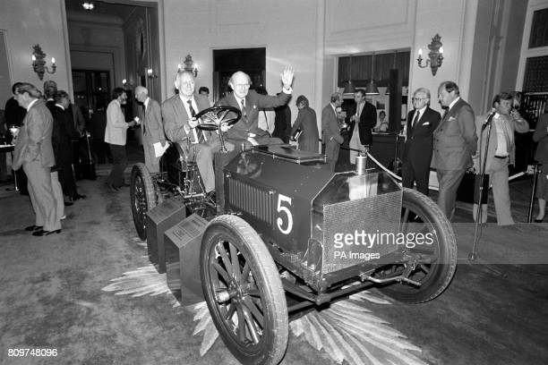 ** Lord Montagu at the wheel of Britain's oldest racing car the 1903 Gordon Bennett Napier with Lord Charteris waving from the passenger's seat at...