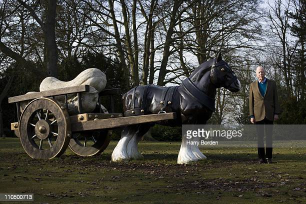 Lord Nathaniel Rothschild poses for a portrait shoot by a sculpture called Perceval by Sarah Lucas in Waddesdon on March 5 2010