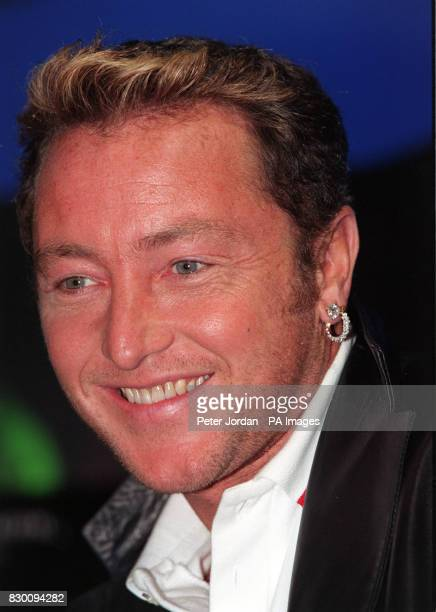 Lord of the Dance star Michael Flatley poses for the media during a photocall in the HMV store in London's Oxford Street today where he signed copies...