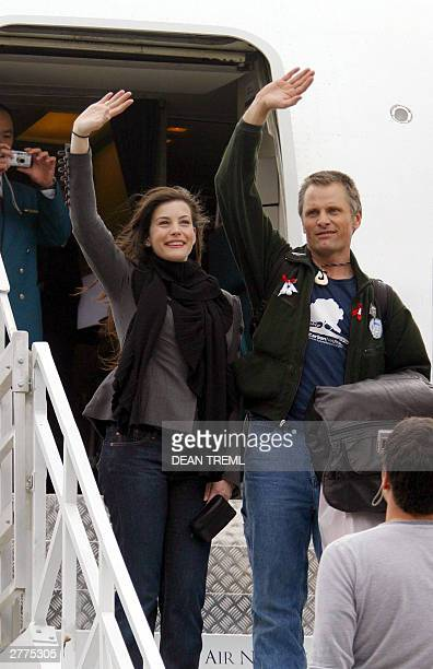 Lord of The Rings stars Liv Tyler Viggo Mortense wave at fans while boarding their Air New Zealand 767 emblazoned with Lord of the Rings imagery...