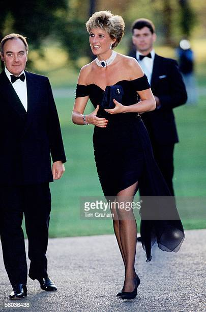 Lord Palumbo greets Princess Diana wearing a short black cocktail dress designed by Christina Stambolian as she atttends a Gala at the Serpentine...