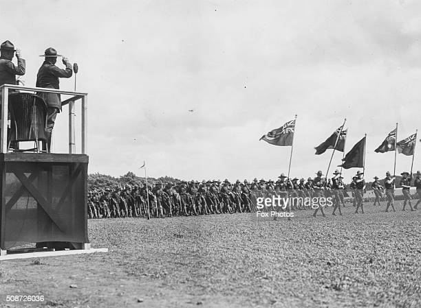 Lord Robert BadenPowell Chief of the Scouts saluting from a platform as he watches a scout jamboree 1929