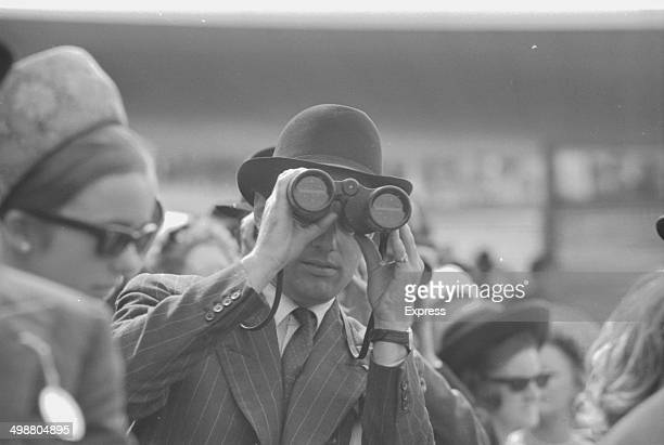 Lord Rosebery looking through binoculars at Goodwood Racecourse Sussex July 28th 1964