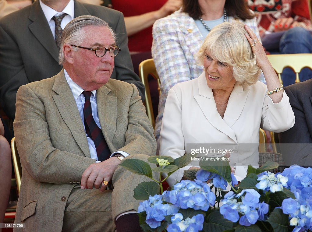 Lord Samuel Vestey and <a gi-track='captionPersonalityLinkClicked' href=/galleries/search?phrase=Camilla+-+Duchess+of+Cornwall&family=editorial&specificpeople=158157 ng-click='$event.stopPropagation()'>Camilla</a>, Duchess of Cornwall watch the show jumping phase of the Badminton Horse Trials on May 6, 2013 in Badminton, England.