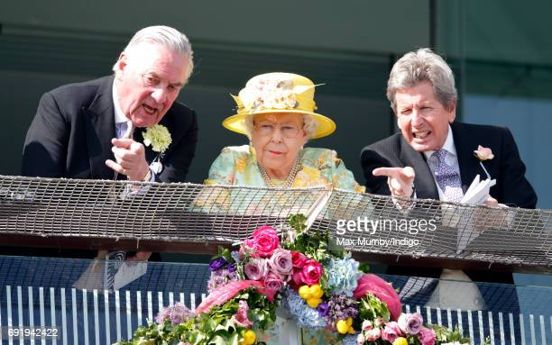 Lord Samuel Vestey Queen Elizabeth II and John Warren watch the racing as they attend Derby Day during the Investec Derby Festival at Epsom...