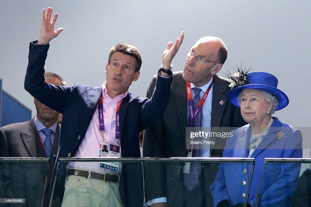 Lord <a gi-track='captionPersonalityLinkClicked' href=/galleries/search?phrase=Sebastian+Coe&family=editorial&specificpeople=160624 ng-click='$event.stopPropagation()'>Sebastian Coe</a> (L), Chairman of the London Organising Committee of the Olympic Games speaks with Queen <a gi-track='captionPersonalityLinkClicked' href=/galleries/search?phrase=Elizabeth+II&family=editorial&specificpeople=67226 ng-click='$event.stopPropagation()'>Elizabeth II</a> attends the morning competition of the swimming on Day One of the London 2012 Olympic Games at the Aquatics Centre on July 28, 2012 in London, England.