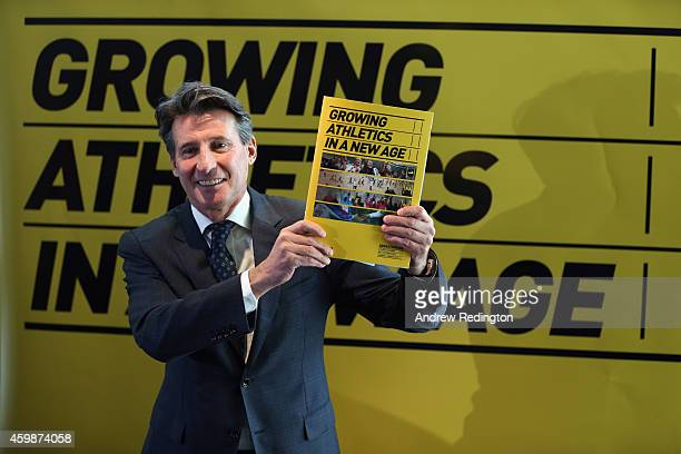 Lord Sebastian Coe poses with his IAAF Presidential Campaign Manifesto at the British Olympics Association offices on December 3 2014 in London...