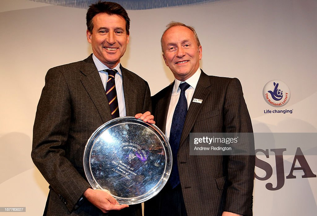 Lord <a gi-track='captionPersonalityLinkClicked' href=/galleries/search?phrase=Sebastian+Coe&family=editorial&specificpeople=160624 ng-click='$event.stopPropagation()'>Sebastian Coe</a> (left) receives the JL Manning award from David Walker during the SJA 2012 British Sports Awards at The Pavilion at the Tower of London on December 6, 2012 in London, England.