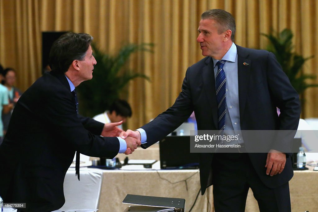 Lord Sebastian Coe (L) shake hands with Sergey Bubka prior to the199th IAAF Council Meeting at Inter Continental Beijing Beichen Hotel on August 17, 2015 in Beijing, China.