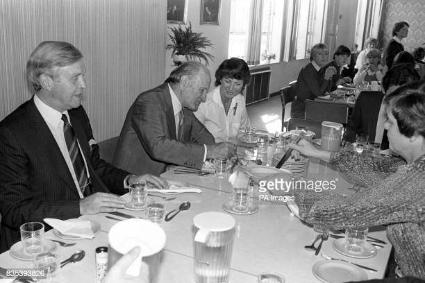 Lord Sieff the Marks and Spencer chief sitting down to eat lunch in a staff canteen of a Sheffield store His meal there was by way of practising what...