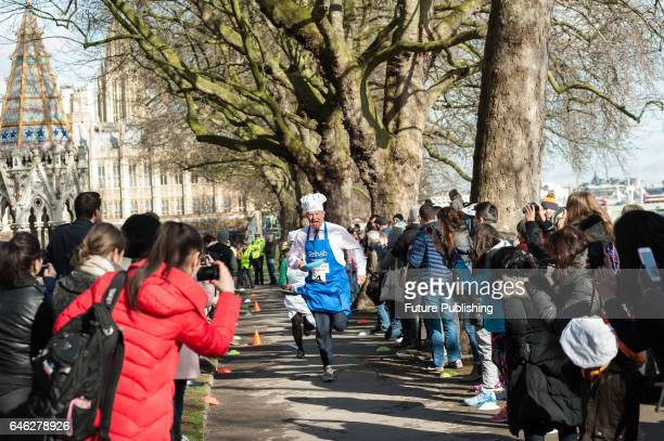 Lord St John of Blesto competes in the 20th Parliamentary Pancake Race on Shrove Tuesday also known as Pancake Day or Fat Tuesday in Victoria Tower...